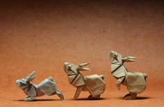 """Rabbits in Motion,"" designed by Ronald Koh, Folded by Ng Boon Choon of Singapore/Malaysia. / 17 Pieces of Origami From a Huge New Show About Paper Folding Origami Paper Art, Origami Box, Origami Ideas, Paper Crafts, Origami Instructions, Origami Tutorial, Akira, Origami Modular, Little Presents"