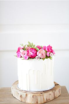 White+Chocolate+Drip+Cake+with+Pink+Wax+Flowers