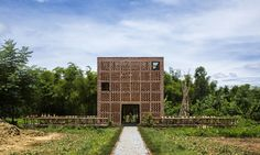 The three-story building, inspired by traditional Vietnamese architecture and the surrounding natural landscape, is located next to Thu Bon river in Vietnam's Quang Nam Province.