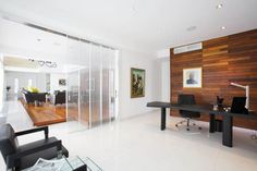 Spacious minimalist home office with black decor