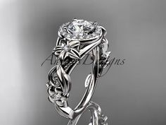 14kt white gold diamond unique engagement ring,wedding ring. This is gorgeous unique engagement diamond ring.It has 22 VS-SI/G-H color diamonds total weight of 0.22ct. The center stone is 1.0ct white sapphire All sizes are available. This ring would make excellent engagement ring or a