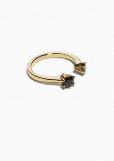 Made from brass, this high-shine ring features two luxe rhinestones. Jewelry Chest, Pomellato, Black Rings, Jewelery, Bling, Brass, Engagement Rings, Bracelets, Beautiful Things