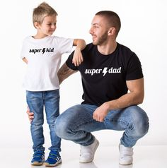 Super Dad Super Kid, Matching Daddy and Me Shirts. Daddy's my hero, he's showing me the world. The perfect outfit for all the dads and their kids! Get now!