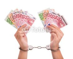 Money in handcuffs. Symbol for corruption in Europe.