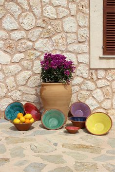 Terracotta serving bowls made in Mallorca.http://www.greetingsfrommallorca.com/en/products/for-home