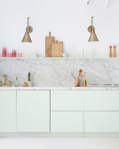 WEBSTA @ ohhappyday - Studio kitchen! Pretty brass lights from @jossandmain (picture styled by @kendrasmoot )