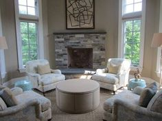 Mrs. Howard: In the sitting room, we arranged four club chairs around a round ottoman to function more as an area for conversation rather than TV-watching. This provides the family plenty of options for relaxation.