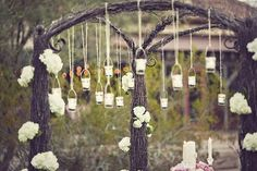 love the look of Mason Jars hanging from a tree. Maybe I can use a photo shoot as an excuse for this?