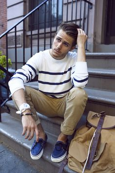 Shop this look for $128: http://lookastic.com/men/looks/white-and-navy-crew-neck-sweater-and-khaki-chinos-and-blue-boat-shoes-and-tan-backpack/1076 — White and Navy Horizontal Striped Crew-neck Sweater — Khaki Chinos — Blue Boat Shoes — Tan Backpack