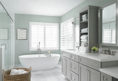 Modern Tub With Natural Light - A regal modern tub works well with pale colors elsewhere