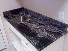 Silver Wave Granite Kitchen Counters And Backsplash In