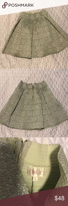 Amazing sparkle skirt I seriously love this skirt!!! It's a high waist, stretchy pleated sparkle skirt.  It slims your waist and makes any top look super sexy on! It's pretty much brand new. I wore to an event and it's just been sitting in my closet. Skirts
