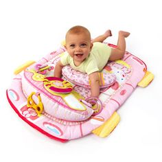 Alayleah will love this def gunna get it for her!!!!! Bright Starts - Tummy Cruiser Prop & Play Mat, Pink