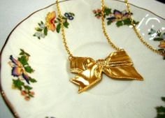 It's a Bow Necklace Gold Plated by luvswoodencars2 on Etsy, $16.00