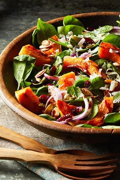 This quick and easy 50-minute roasted squash and spinach salad recipe incorporates butternut squash, balsamic vinegar, honey, spinach, parmesan cheese, cranberries and almonds to create the ultimate fall recipe. Whether you're looking to eat this butternut squash recipe as a fast weeknight dinner, side dish, appetizer, snack or light lunch, it's a great choice for a fall recipe. #fallrecipes #butternutsquashrecipes #butternutsquash #saladrecipes #fallsalads