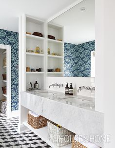 Artful floors are having a major moment in just about any room in the house, but in the bathroom high-impact tiles are practical, and a fun way to inject high-octane pattern.   Photographer: Valerie Wilcox   Designer: Kai Ethier