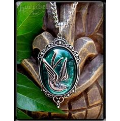Aqua Swallow Pendant Necklace.  It really is pretty, huh?