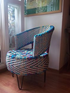 chair woven over with textile waste chords,incorporates an old car tyre as the seat.