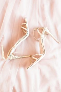 Blingy metallic wedding shoes: Photography : Lauren Gabrielle Photography Read More on SMP: http://www.stylemepretty.com/ohio-weddings/2016/02/01/elegant-ohio-blush-ballroom-wedding/