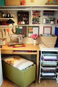 Cozy Craft space- love the ottoman/bench/file storage idea!