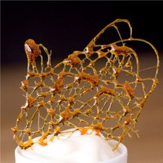 4 ways to make gorgeous caramel garnishes, like this caramel lace. Also caramel spikes & cookie feet