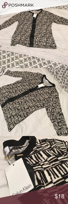 Calvin Klein Long sleeve blouse Multi color & black long sleeve blouse. Made of  polyester & spandex w/faux leather & gold colored clasps. Size Large. Calvin Klein Tops Blouses