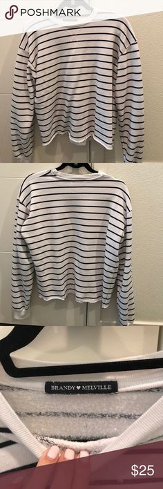 Brandy Melville Striped Pullover Brandy Melville 💕 black and white striped pullover with raw hem at the bottom. No size but fits small. Only worn a couple times and still in great condition! Brandy Melville Tops Sweatshirts & Hoodies