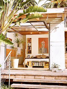 Joshua Coggenshall created a wall for the couple's bedroom addition that tilts upward, like a garage door. A system of pulleys, rope, and cleats allows the wall to be raised easily, extending the living space out onto the deck.