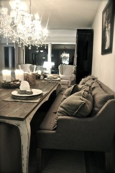 Dont be afraid to incorporate grand lighting design in your small space. Sofa Does Double Duty - Perfect Set-up For a Small Condo/Apartment