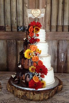 Half and half wedding cake with fresh flowers and tuxedo strawberries by pattibcakes in spicewood tx