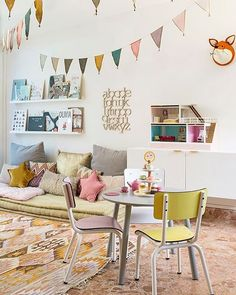 Playroom goals 🙌 Loving the retro chairs and beautiful rug :) Colour combo matches perfectly with the Número74 garlands and cushions. And let's not forget Mr. Fox who snuck in on the right ;) You can find these items at Talo. X Image source - Pinterest. Please let me know if you know the original source! #playroom #fionawalkerengland #garland #starcushion #numero74 #retrochairs #foxhead #nurserydecor #homedecor #interiors #shopsmall #interiordesign #interior4all #talointeriors