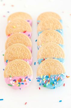 an easy + bright party snack = oreos dipped in frosting and sprinkles