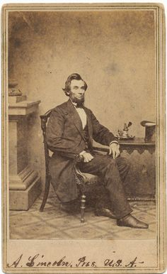 """ABRAHAM LINCOLN: A wonderful carte de visite of President-elect. """"O-51 Ink Well"""" from the famous series of five photographs taken at Lincoln's first sitting in Washington by Alexander Gardner, in Mathew Brady's National Portrait Gallery on Sunday, February 24, 1861. with notations on recto and verso (none in Lincoln's hand). Lincoln possesses what his private secretary, John Nicolay, referred to as """"that serious far-away look"""", as if he were lost in thought."""