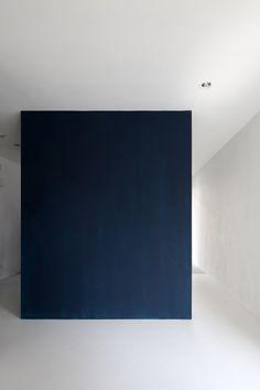 Dark box inside a white interior. Small Core House in Ochiaigawa by UNIT-O.