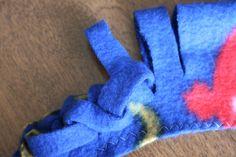 using a scrap of fleece to test the woven edge braiding for a fleece blanket
