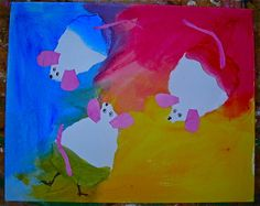 Students started with yellow cake tempera and painted about one third of their background, starting at the corner and brushing towards the center. Then, after getting their brushes REALLY clean they did the same with red paint, overlapping part of the yellow, creating orange. When they added blue, they overlapped both red and yellow, making purple and green.