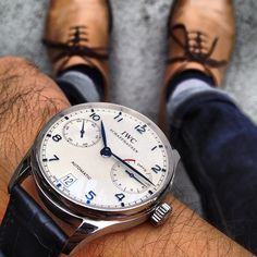 Blue hands, white face, IWC...