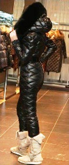 Girl in black shiny downsuit...