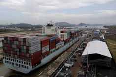 A cargo ship named Cosco Houston, navigates through Cocoli locks during a test of the new set of locks of the Panama Canal expansion project on the Pacific side in Cocoli, on the outskirts of Panama City, Panama June 23, 2016.  REUTERS/Carlos Jasso