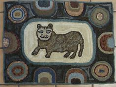 vintage Peggy Teich folk art hand hooked rug on burlap, a Cat
