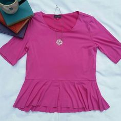 Vince Camuto top Beautiful pink Vince Camuto peplum top with a slight high-low. Half sleeves- size medium- in excellent condition!    FINAL PRICE-- Bundle for a discount! Always fast shipping! Vince Camuto Tops Blouses