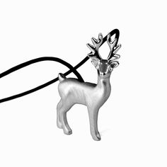 Unique solid sterling silver deer necklace pendant, in matte finishing with glossy details to highlight the design. A micro-sculpture in a jewel, your perfect Christmas accessory! #Christmasgift #deernecklace #deerjewelry #Christmasnecklace #deercharm #Christmaspendant #deerpendant #deergift