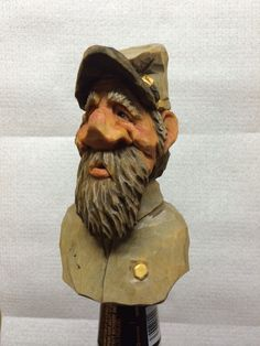 Caricature wood carving bottle stopper by Dwayne Gosnell