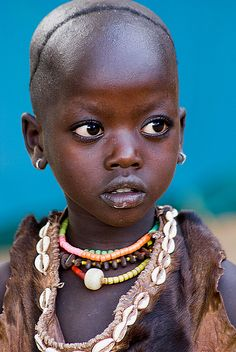 World Cultures. Young girl from the Hamar tribe, Ethiopia. This picture won its photographer many awards! I tried to get it to pin from the source for even more info but could not. Lovely photo!