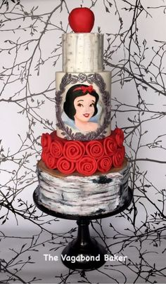 This splendid Snow White cake is a four tiered cake with a silver framed hand-painted portrait of Snow White on one of the middle tiers of the cake. There is red fondant apple on top of the cake. The top tier of the cake is a painted to look like. Gorgeous Cakes, Pretty Cakes, Cute Cakes, Amazing Cakes, Minni Mouse Cake, Snow White Cake, Cake Wrecks, Gateaux Cake, Crazy Cakes
