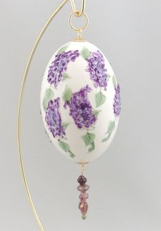 Blooming with purple lilacs, this beautiful egg ornament looks like it's just been picked from your garden. Created from a whole, uncut, empty