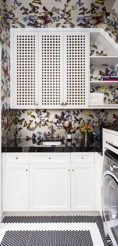 Butterfly wallpaper in laundry room with white shelves