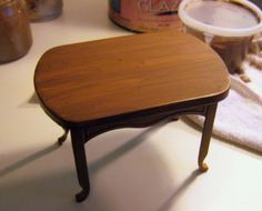 Painting faux wood grain on plastic Barbie furniture.  Yes!!