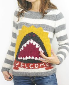 Free Knitting Pattern for Welcome Shark Sweater - Long-sleeved pullover with intarsia shark jaws on a striped background. Sizes XS,S, M, L, 1X, 2X, 3X. Designed by Teresa Yoon for Knitty