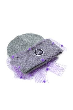 "Classic Beanie with a Silver Spoon Twist. Tulle mesh bow hand sewn. SSA ""eye"" logo sewn underneath mesh. Wear bothways! 100% super soft yarn. DELIVERY OPTIONS"
